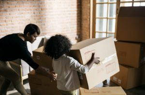 New Start Staging - Life Begins After New Start - Image of children with moving boxes